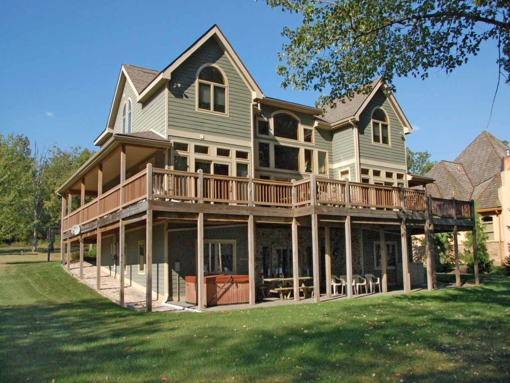 VRBO.com #812847 - Relax on the Massive Wrap Around Deck with a Hot Tub, Overlooking the Level Lake Front. the Family R