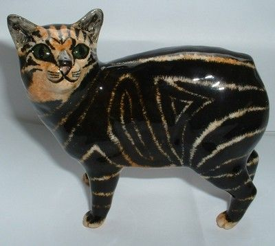SHEBEG ISLE OF MAN earthenware figurine of a black and tan Manx cat