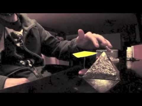 http://www.torgone.com - Orgonite Pyramids definitely give off a bit of orgone energy. I am using the pyramid to build up energy and move the paper balancing...