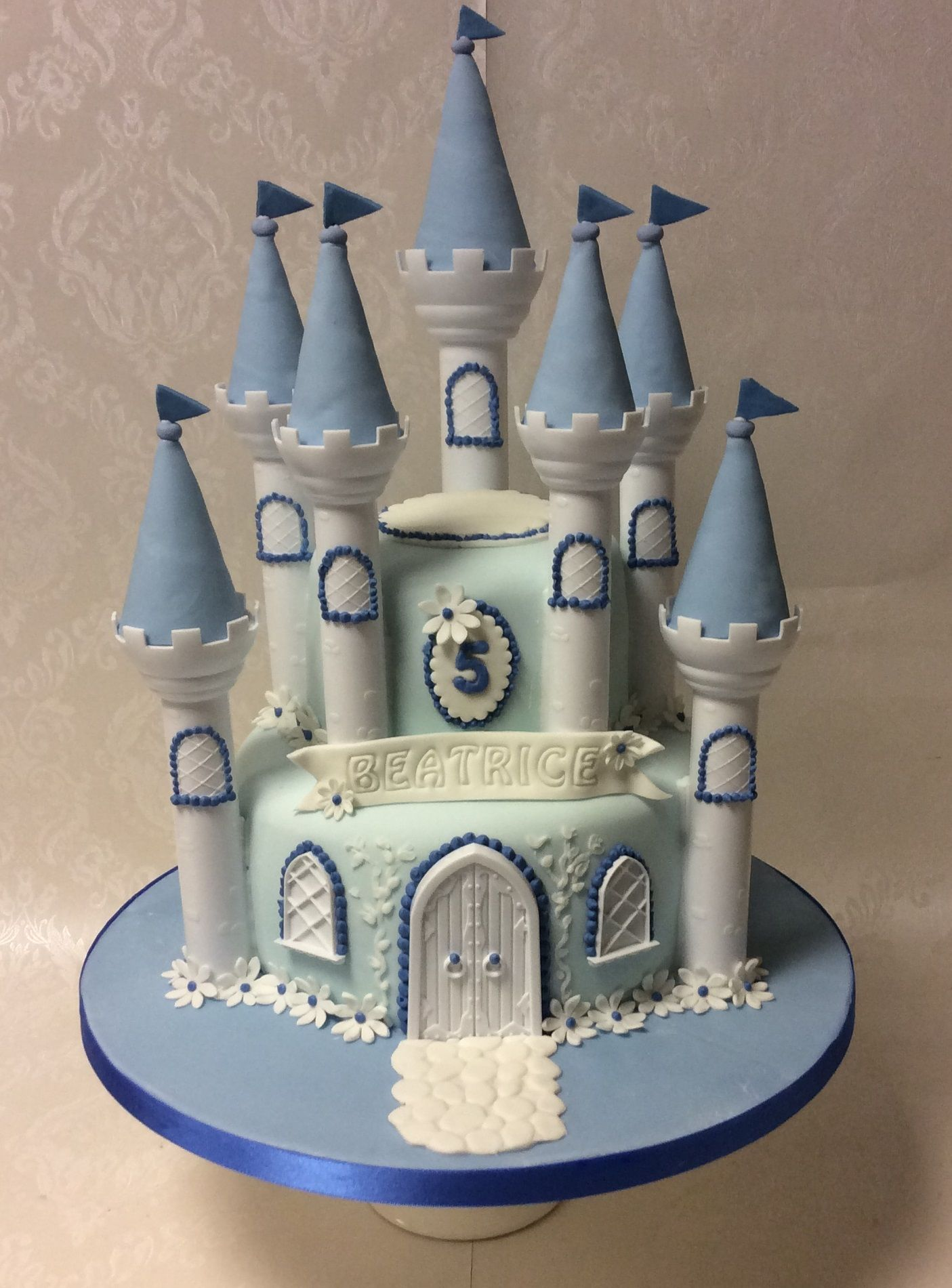 blue white castle with space for a cinderella figure to be added
