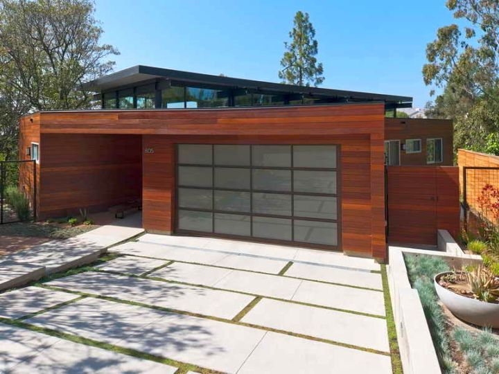Contemporary garage with white pathway contemporary for Contemporary carport design architecture