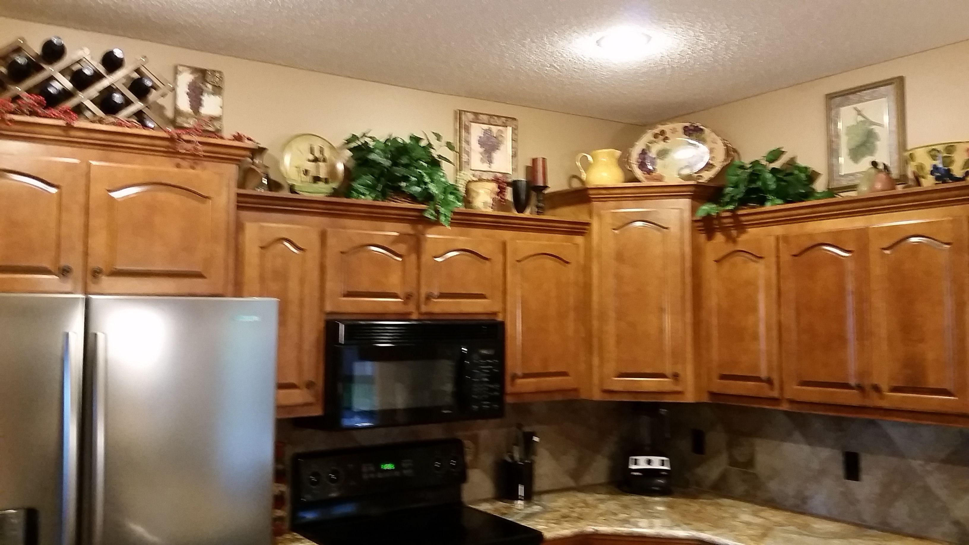 My Husband And I Had A Great Time Decorating Above The Kitchen Cabinets With It Kitchen Cabinets Decor Above Kitchen Cabinets Decorating Above Kitchen Cabinets