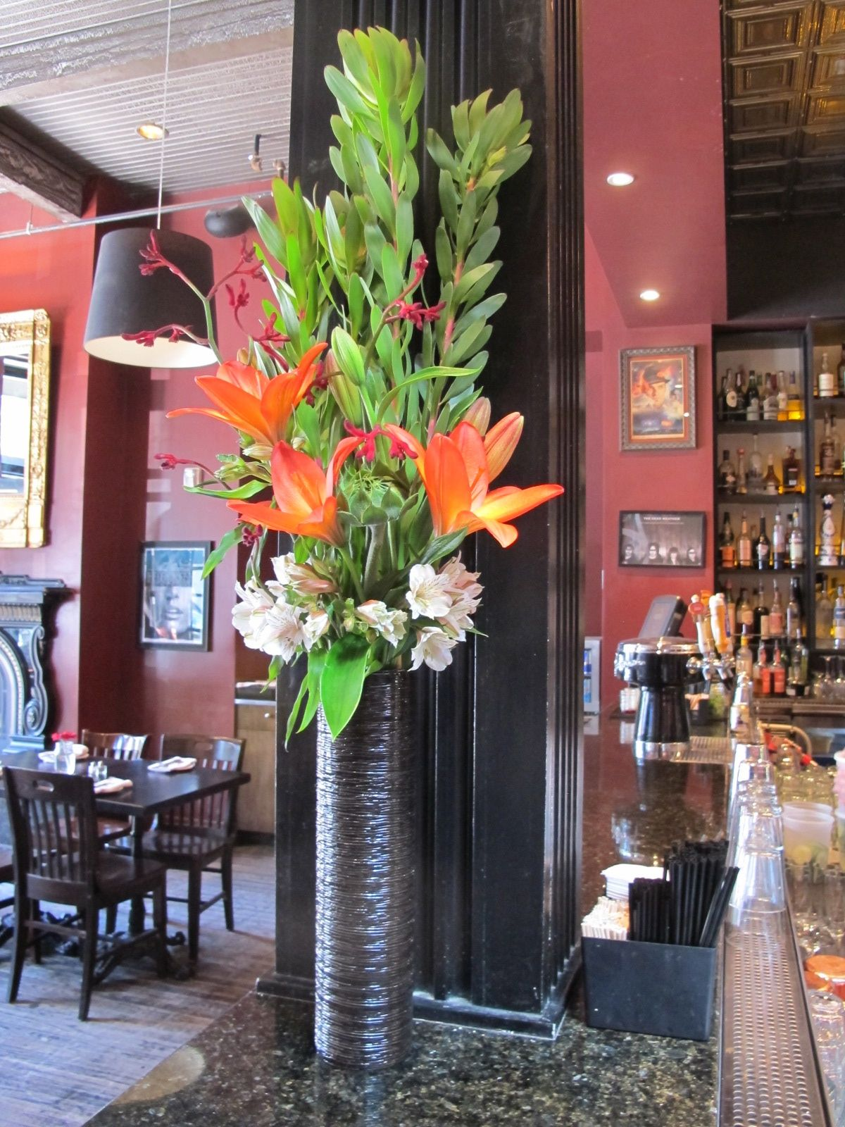 Restaurant Flower Arrangement With Orange Lilies And Safari Sunset For Cinco De Mayo Mums