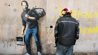 Banksy artwork at the Jungle refugee camp showing Steve Jobs as a migrant, Dec 2015, bbc