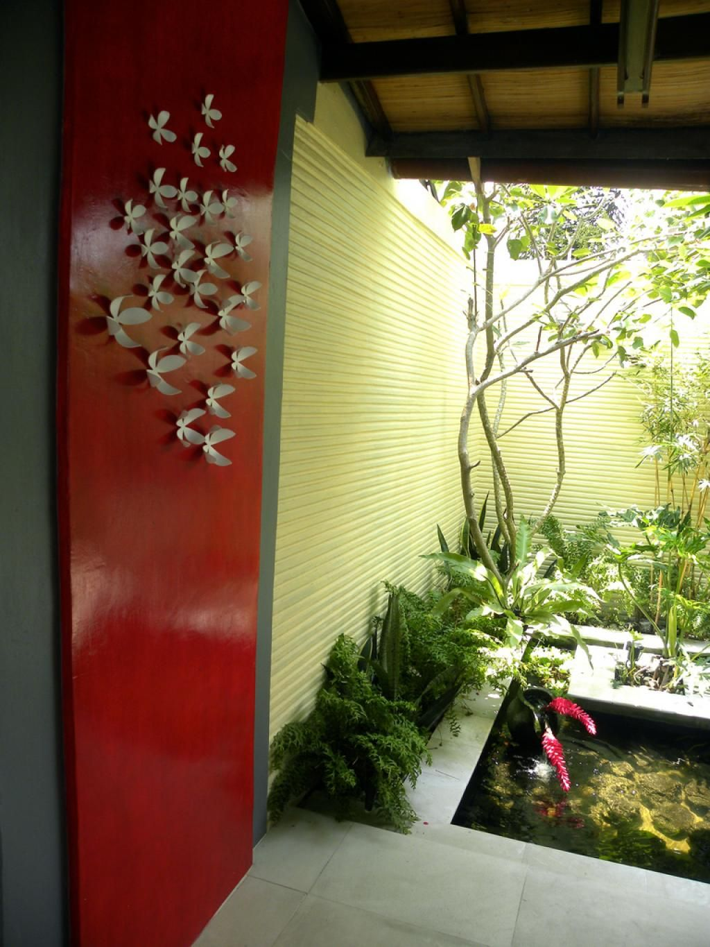healthy home design wall hanging ideas near indoor fish pond