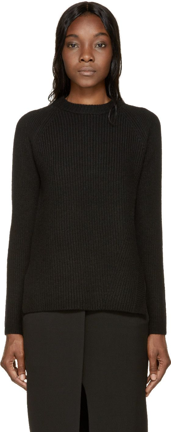 Long-sleeve ribbed knit sweater in black. Ribbed crew-neck collar and side-seam trim. Asymmetrical side-seam vents. Tonal stitching.