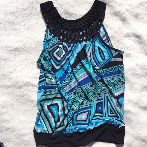 Beautiful blue and black tank top Silky bluesh green tank top. Keep in mind that all used items are final sale and non-returnable Tops Tank Tops
