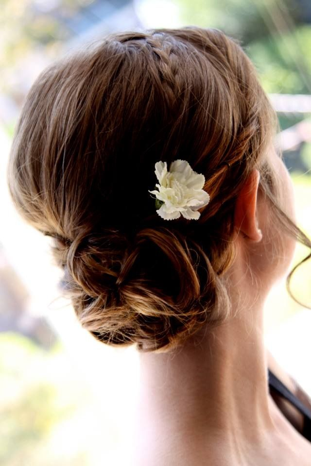 Bridesmaids hair up do with flower