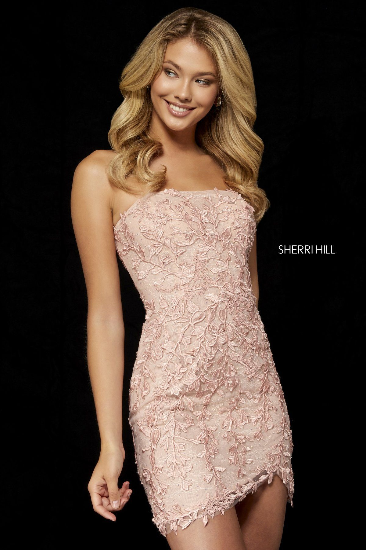 04feea68da1c The strapless neckline is complemented nicely by an asymmetrical short  skirt. The entire dress is covered with lace. This Sherri Hill dress ...