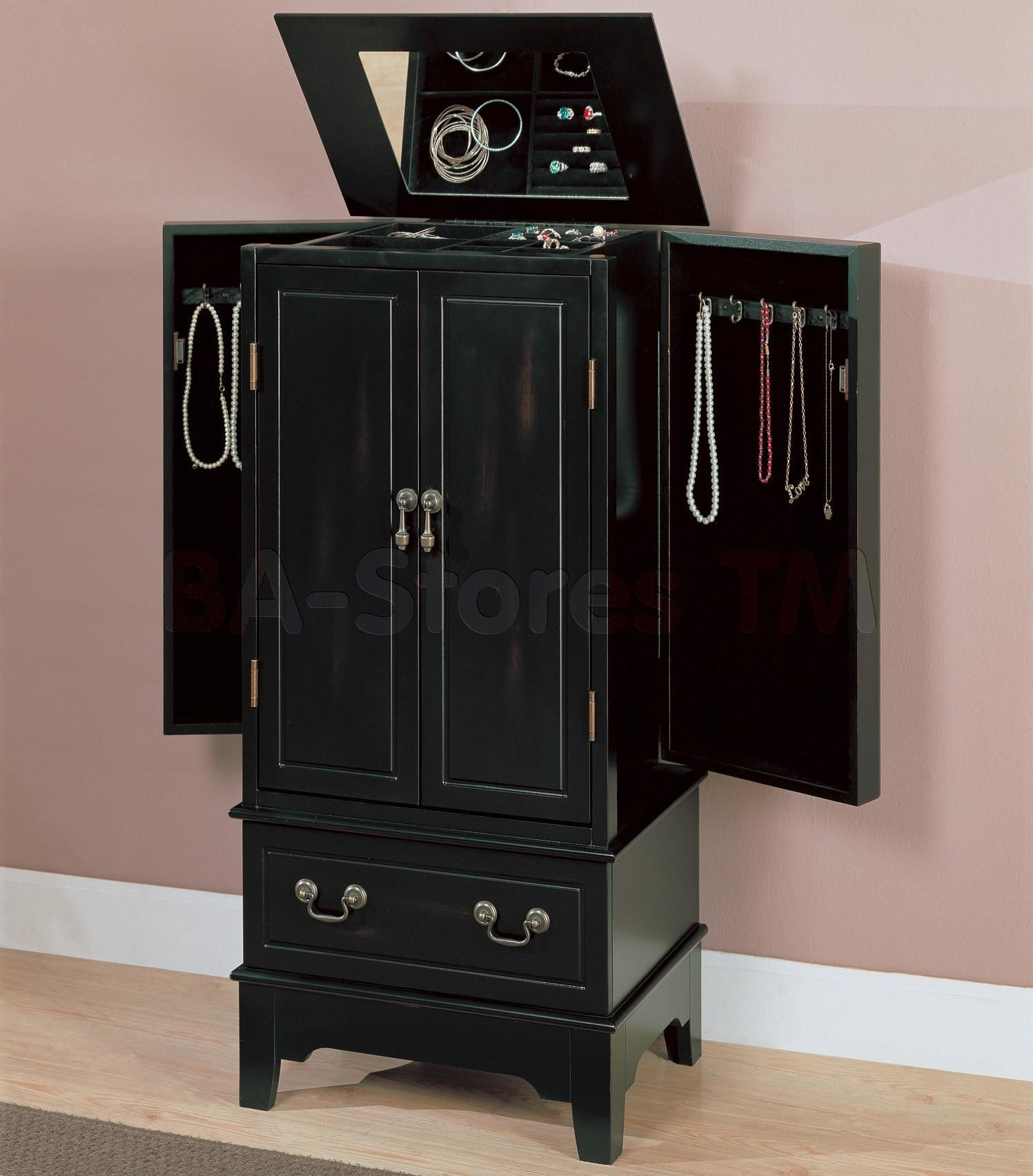 The black jewelry armoire for the dressing room next to the play