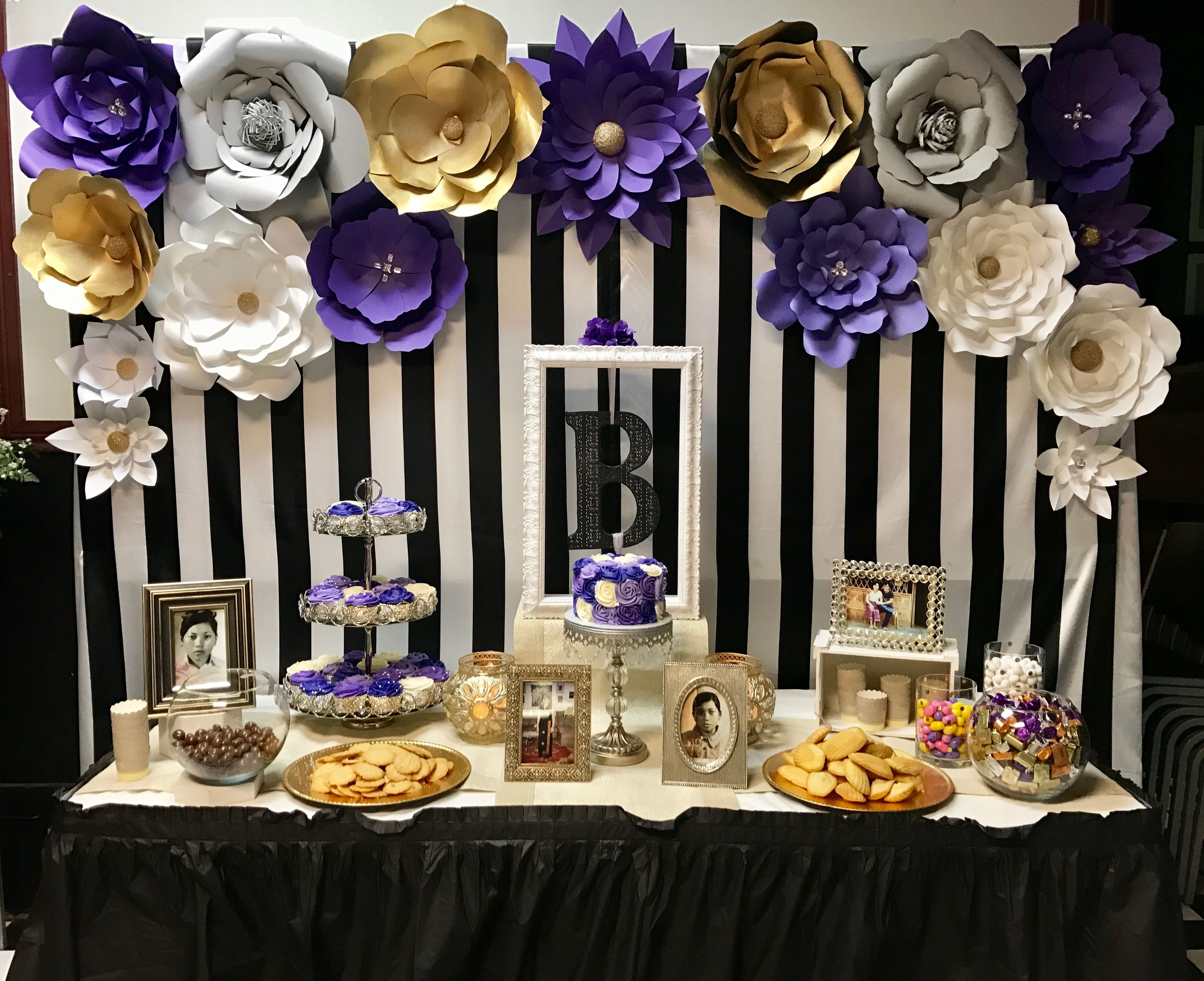 Dessert table with paper flowers backdrop for purple themed 60th birthday party  #purple #birthdayparty #50th #60th