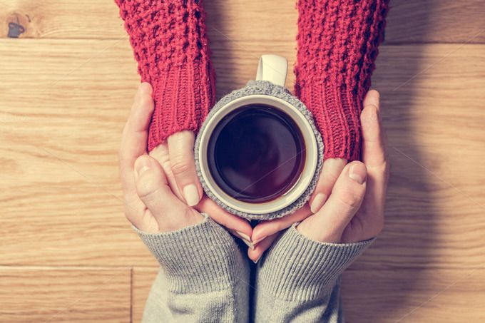 A couple in love warming hands with a hot mug of tea by Photocreo Michal Bednarek on @creativemarket
