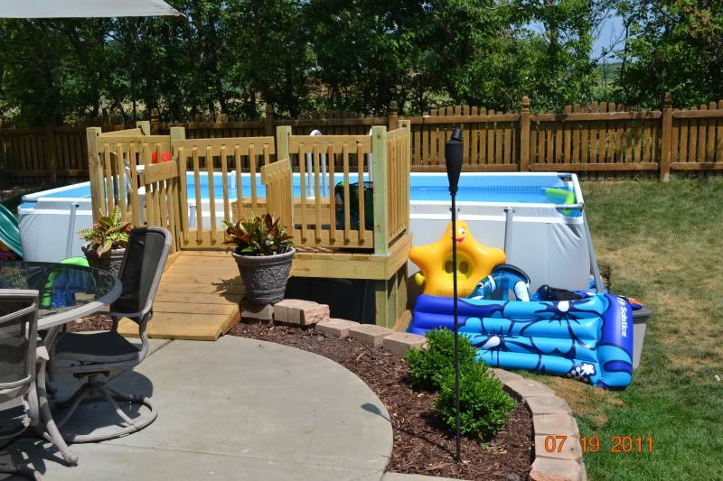 Intex pool beside the deck curb appeal pinterest for Rectangle above ground pool hard sided