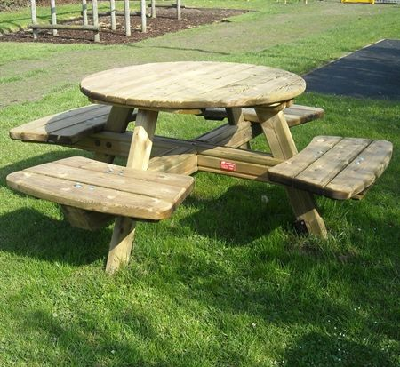 This Wooden Round Picnic Table With Seating For Four Is