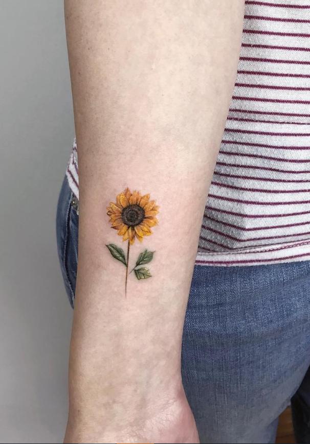 Small Sunflower Tattoo On Wrist Small Tattoo Design For Woman Simple Tattoo Ideas Pretty Female T Sunflower Tattoo On Wrist Beautiful Flower Tattoos Tattoos