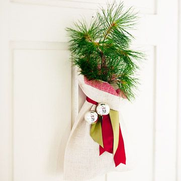 mini christmas tree front door decorationsmall sack made from a small linen towel ribbon bells wrap stems of pine sapling in damp cheesecloth and