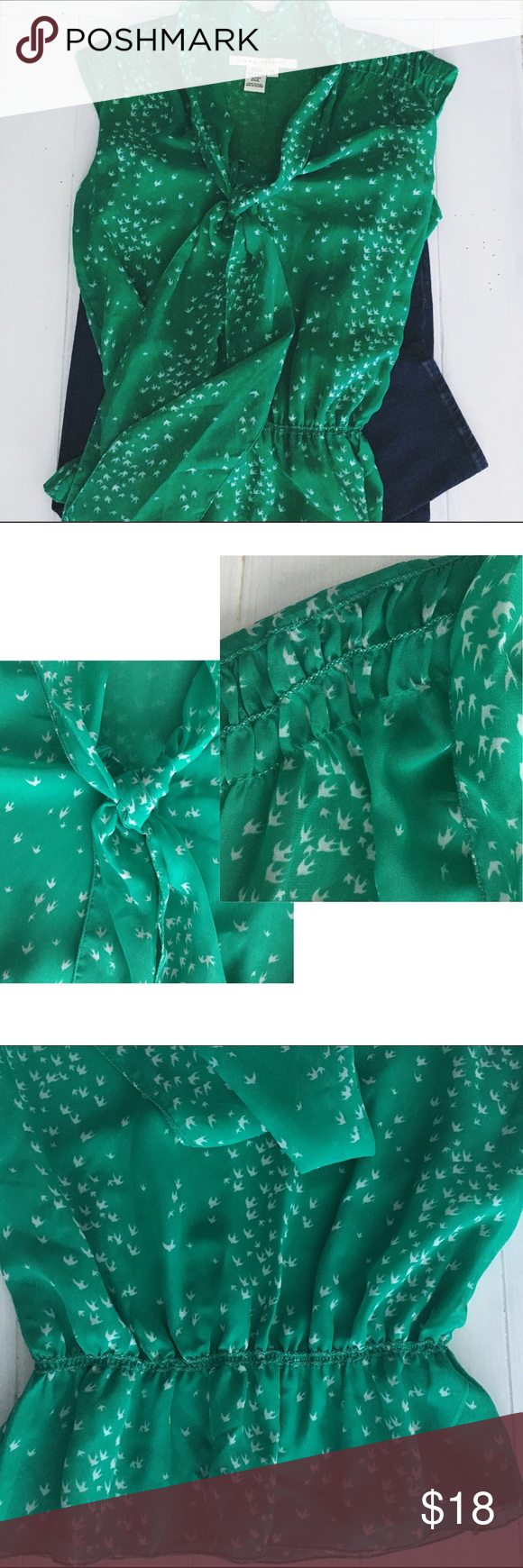 Max Studio Top Birds of a feather definitely stick together as seen in this Mac Studio too. This is a great piece alone or under a blazer. It's a beautiful green color with a white bird pattern. It's sleeveless with an elastic waist. 100% polyester Max Studio Tops