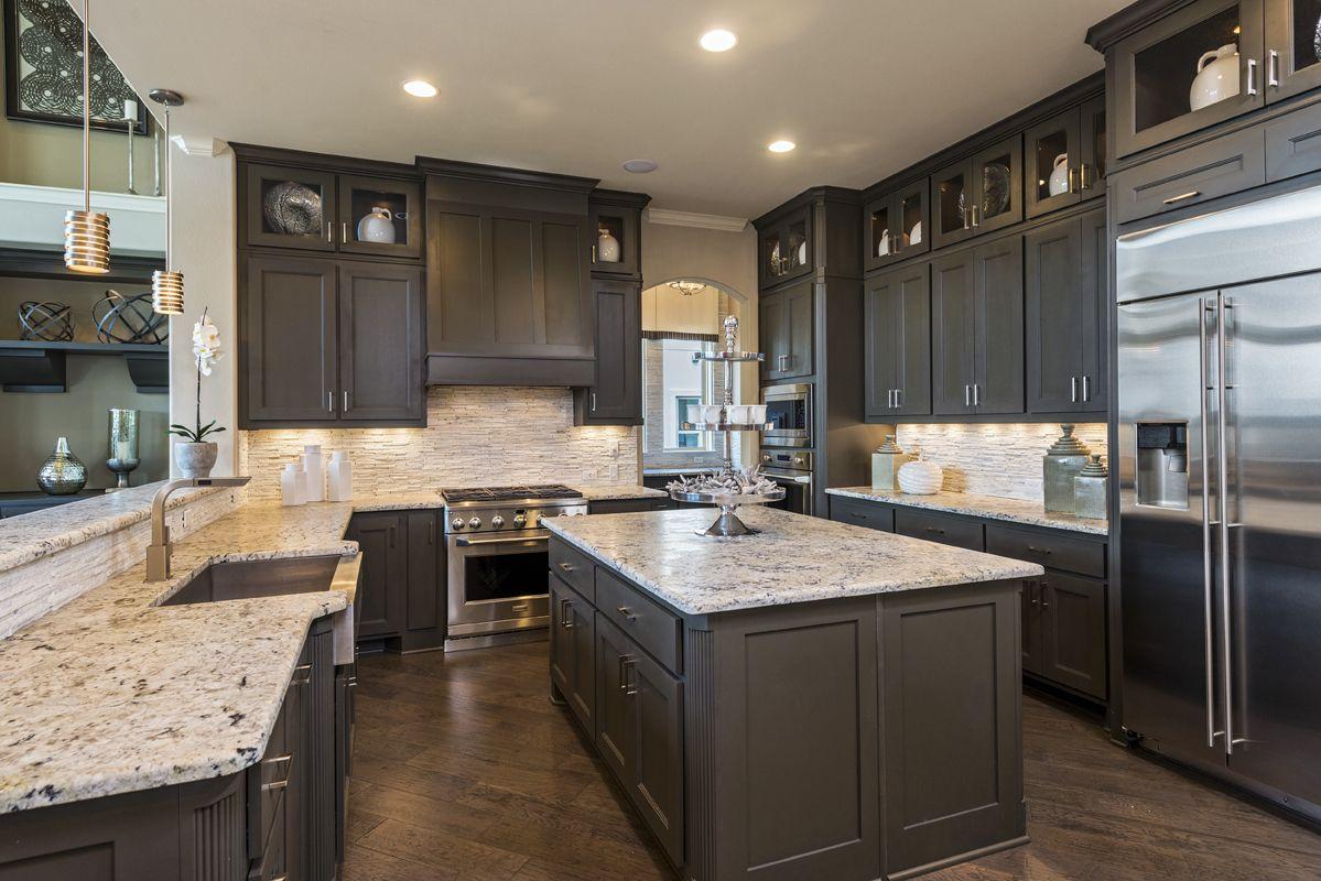 Gourmet Kitchen Design With Granite Counters Backsplash And Dark Brown Cabinetry Dreamkitchen New Homes Home Kitchen Redo