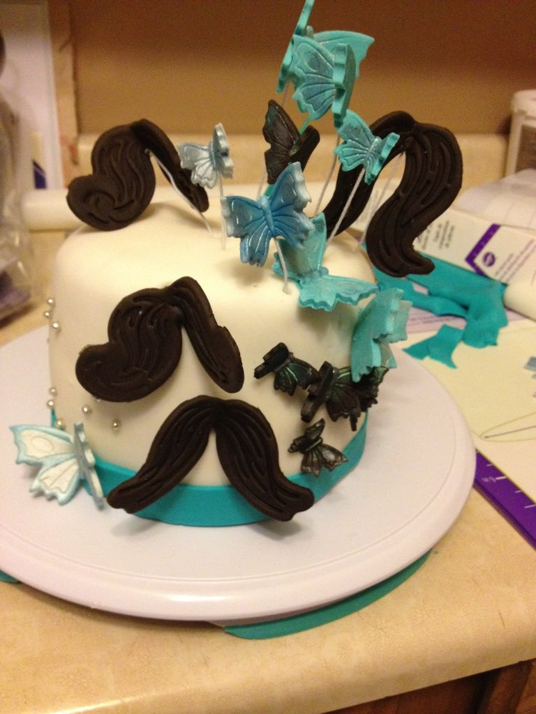 butterfly and mustache wedding cake