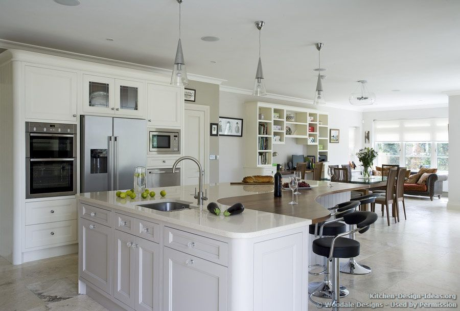 kitchen idea of the day this piano shaped island includes the main sink and a combo of beige on kitchen island ideas white quartz id=52652