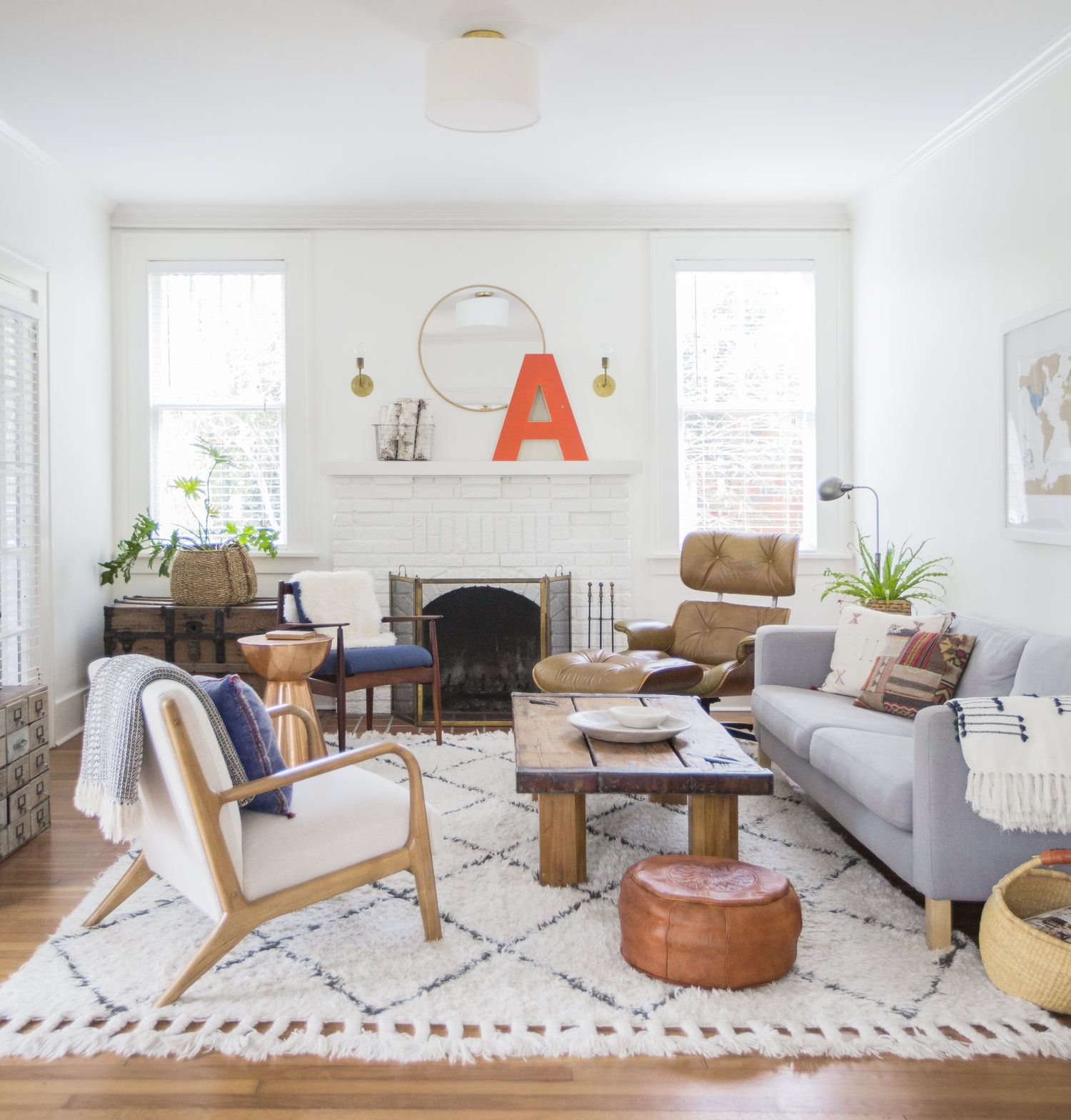 Eclectic White Living Room With Large Shag Boho Area Rug And A White Brick Fireplace Boho Decor Interior Design Bedroom Living Room Designs Livingroom Layout
