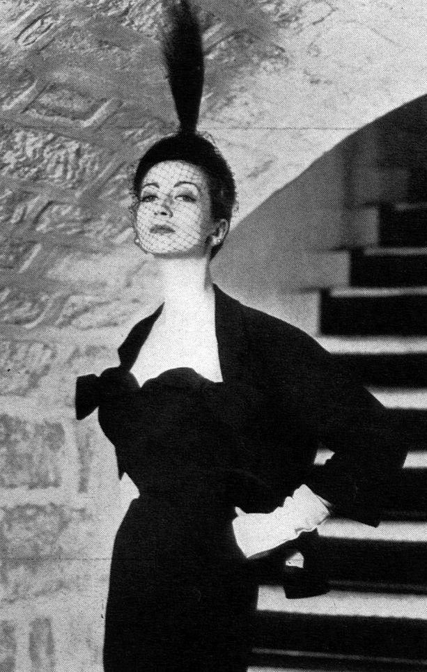 1951 Della Oake in black dinner dress with short bolero jacket by Balenciaga