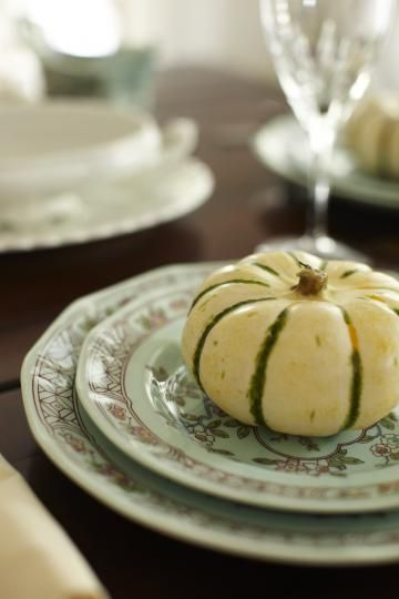 To add another touch of fall to your plates set a small pumpkin or gourd on each guests' plate for them to take home after the meal.