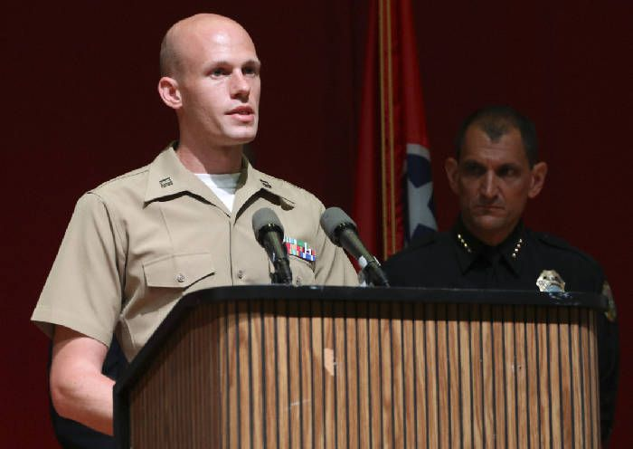 USMC Captain Ty Balzer, left, speaks to media as Chattanooga Police Chief Fred Fletcher listens from behind during a press conference at Tennessee Valley Authority's Missionary Ridge Auditorium on Friday, July 17, 2015 the day after a four Marines were shot and killed. The investigation is being treated as an act of terrorism. Photo by Dan Henry /Times Free Press.