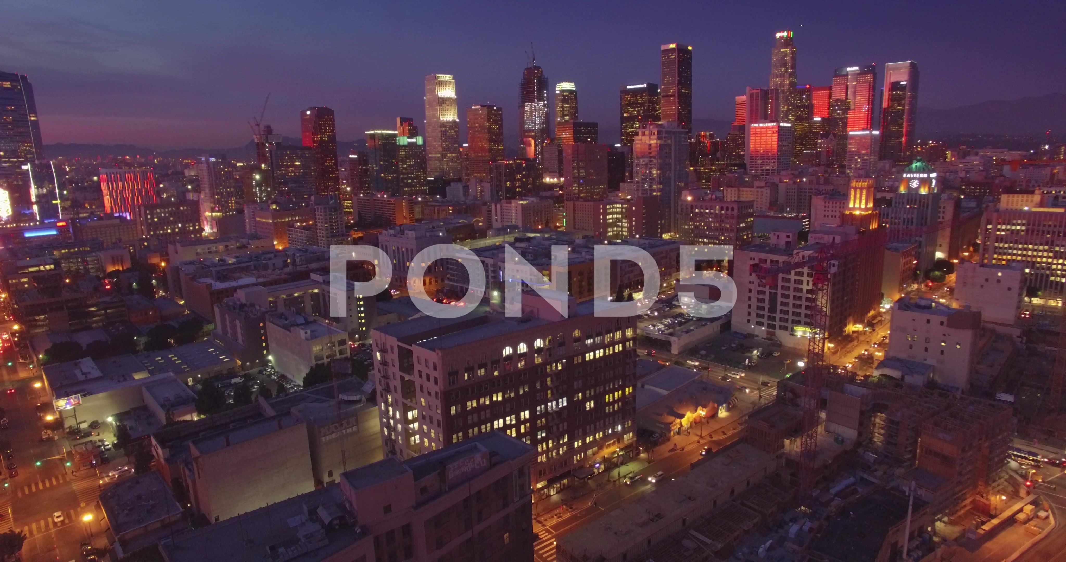 Aerial View Illuminated City Downtown Los Angeles Skyline At Dusk Night 4k Uhd Stock Footage City Downtown Los Aerial Los Angeles Skyline Skyline Aerial View