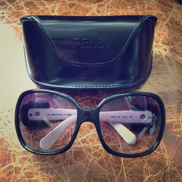 FENDI Sunglasses These FENDI sunglasses were purchased many years ago, either at a NM Last Call or Saks Off Fifth. The frames are black and creamy white, and the lenses have a purplish-black gradient. In excellent condition, and comes with the original case as shown. FENDI Accessories Sunglasses