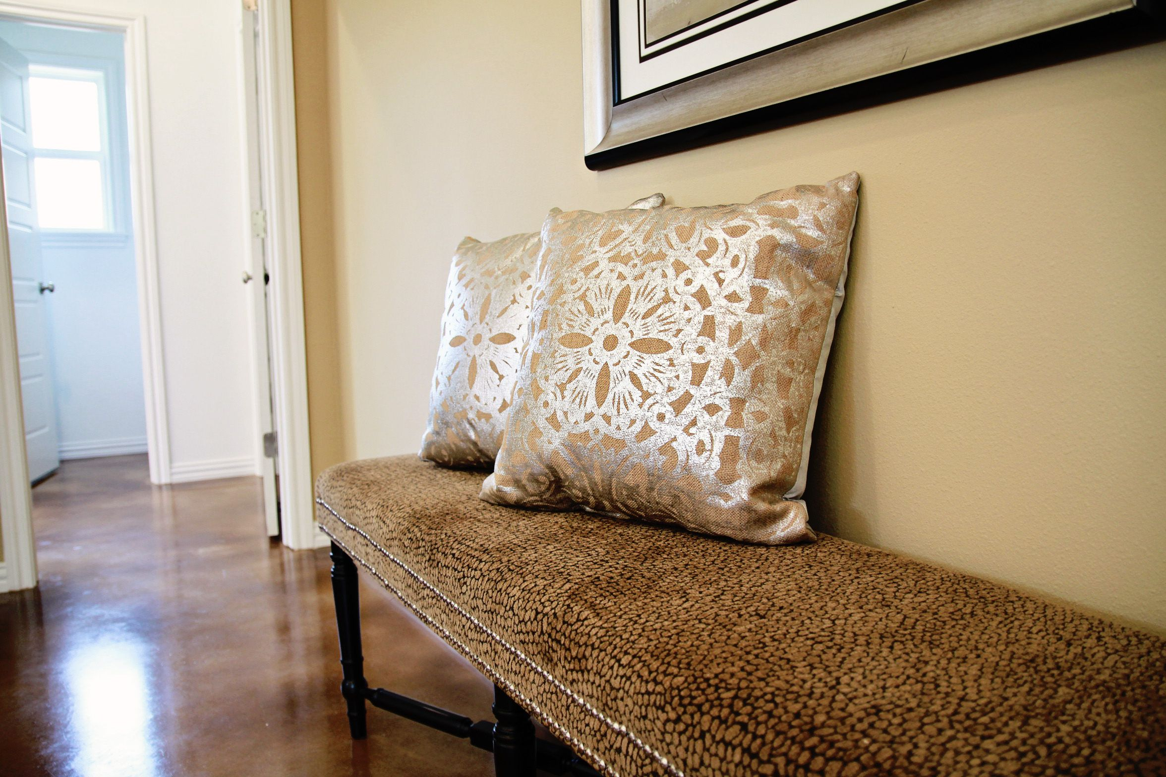 Shiny happy pillows in a lovely bedroom sitting area shimmer