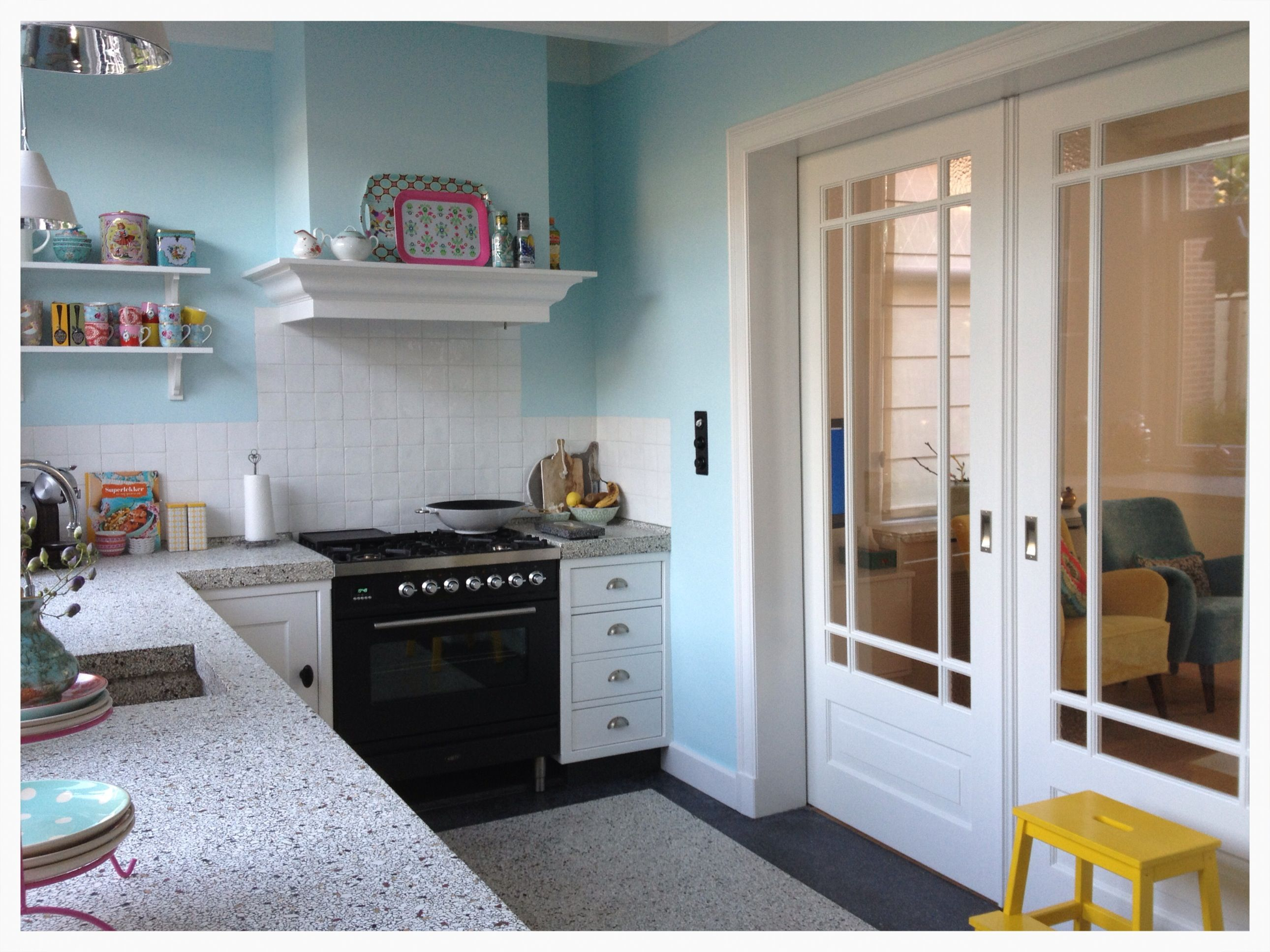 Our new kitchen: blue walls terrazzo floor and work surface