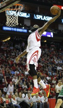 Houston Rockets guard James Harden (13) flies in for the dunk during the  second half of an NBA basketball game at Toyota Center e065717ee