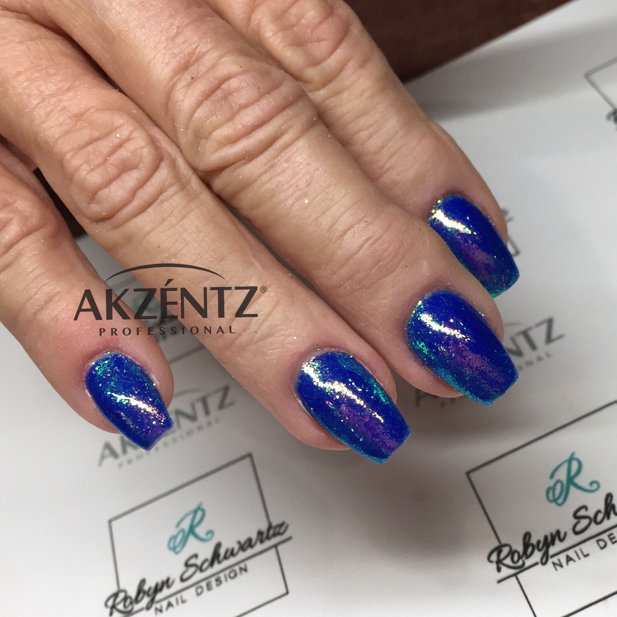 Luxio Lookout with blue iridescent glitters, coffin gel nails ...