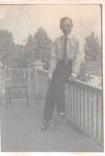 Black and White Vintage Snapshot Photograph Man Smile Porch Railing 1910's