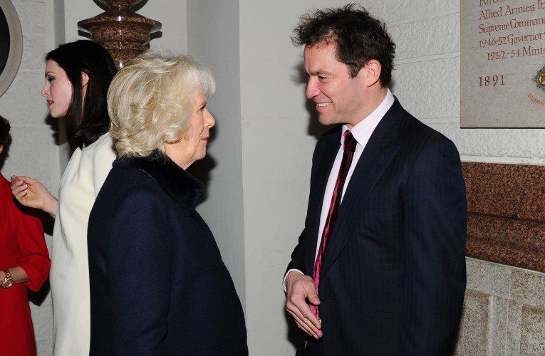Duchess Camilla chatting to Dominic West at Maggie's Christmas Carol concert at St Paul's Cathedral on December 16th.