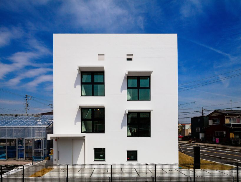 b5661a21bcd hisanori ban connects three storey house with gently ascending ramp ...