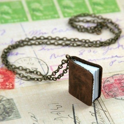 This is the necklace for me! Genuine Leather Mini Journal Necklace by sweetvictorian. On sale at www.etsy.com Le sigh. I would love to have this piece! It actually has a tiny leather binding and tiny pieces of paper in it. I really think this is fun.