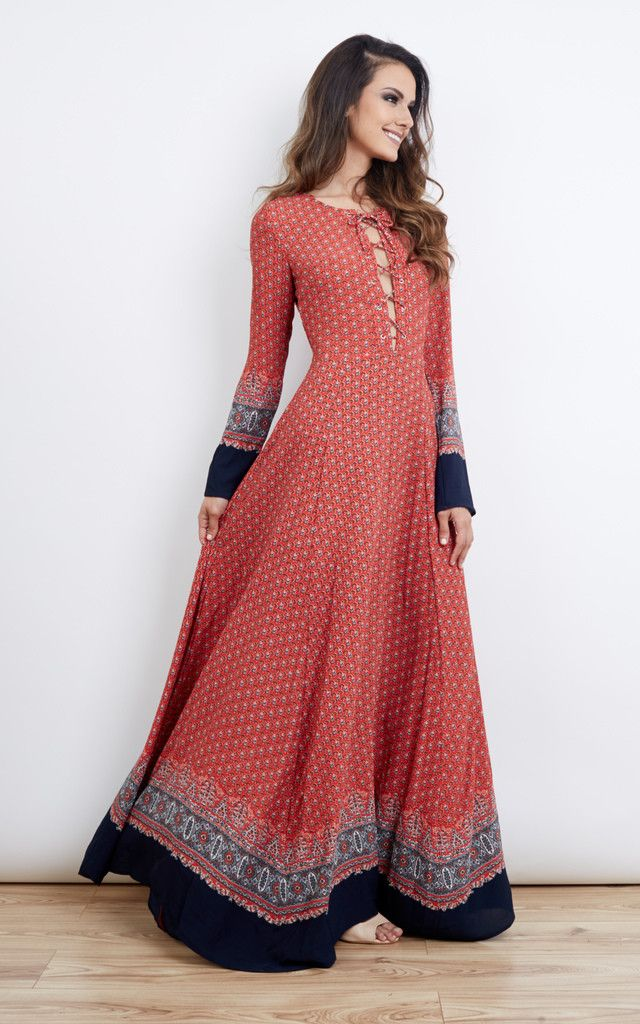 d26eaae9bbd Red navy border print lace up maxi dress. Features long sleeves, lace up  detail at the chest with flared semi-sheer maxi length skirt.
