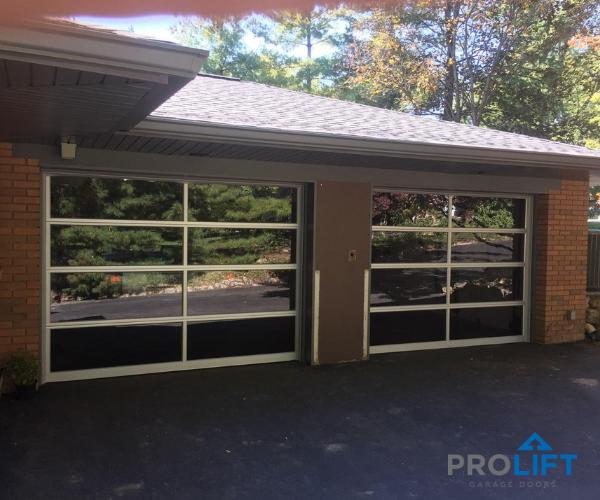 The Benefits Of Glass Garage Doors Garage Door Styles Glass Garage Door Garage Door Design