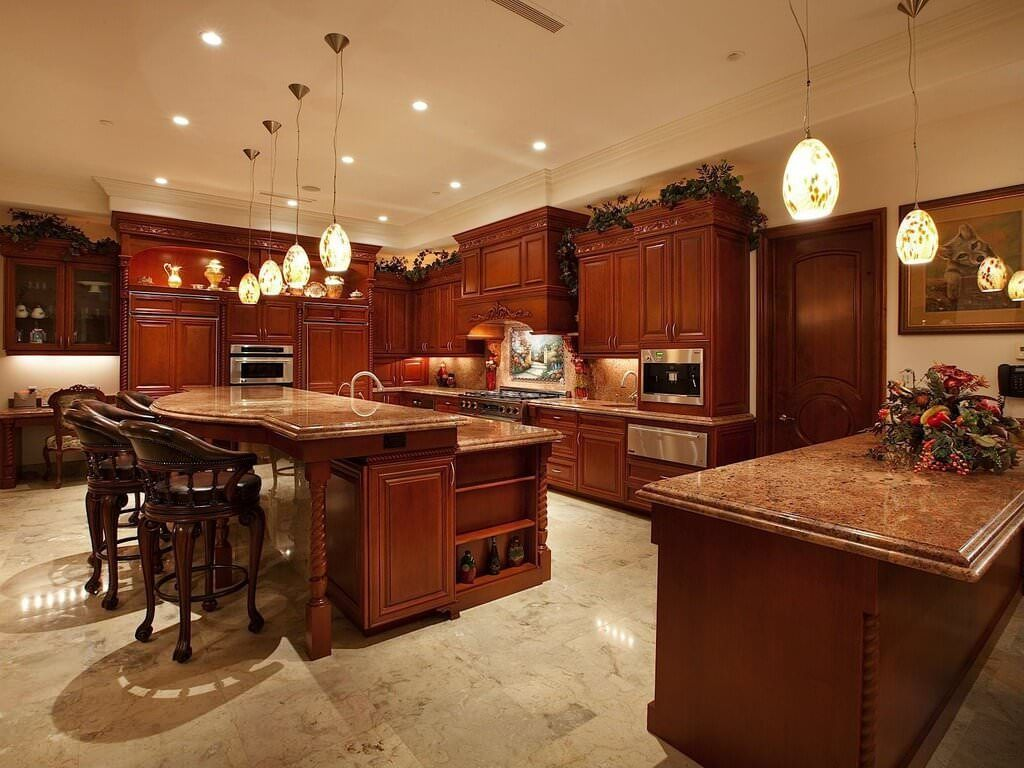Rich Red Wood Over Beige Marble Flooring Throughout This Kitchen Large Two Tiered Island Wit Luxury Kitchen Design Luxury Kitchen Island Kitchen Island Design