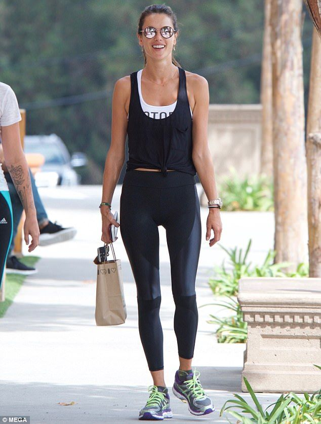 c1e4c73bd6 Alessandra Ambrosio flashes taut tummy in tied up tank after the gym ...
