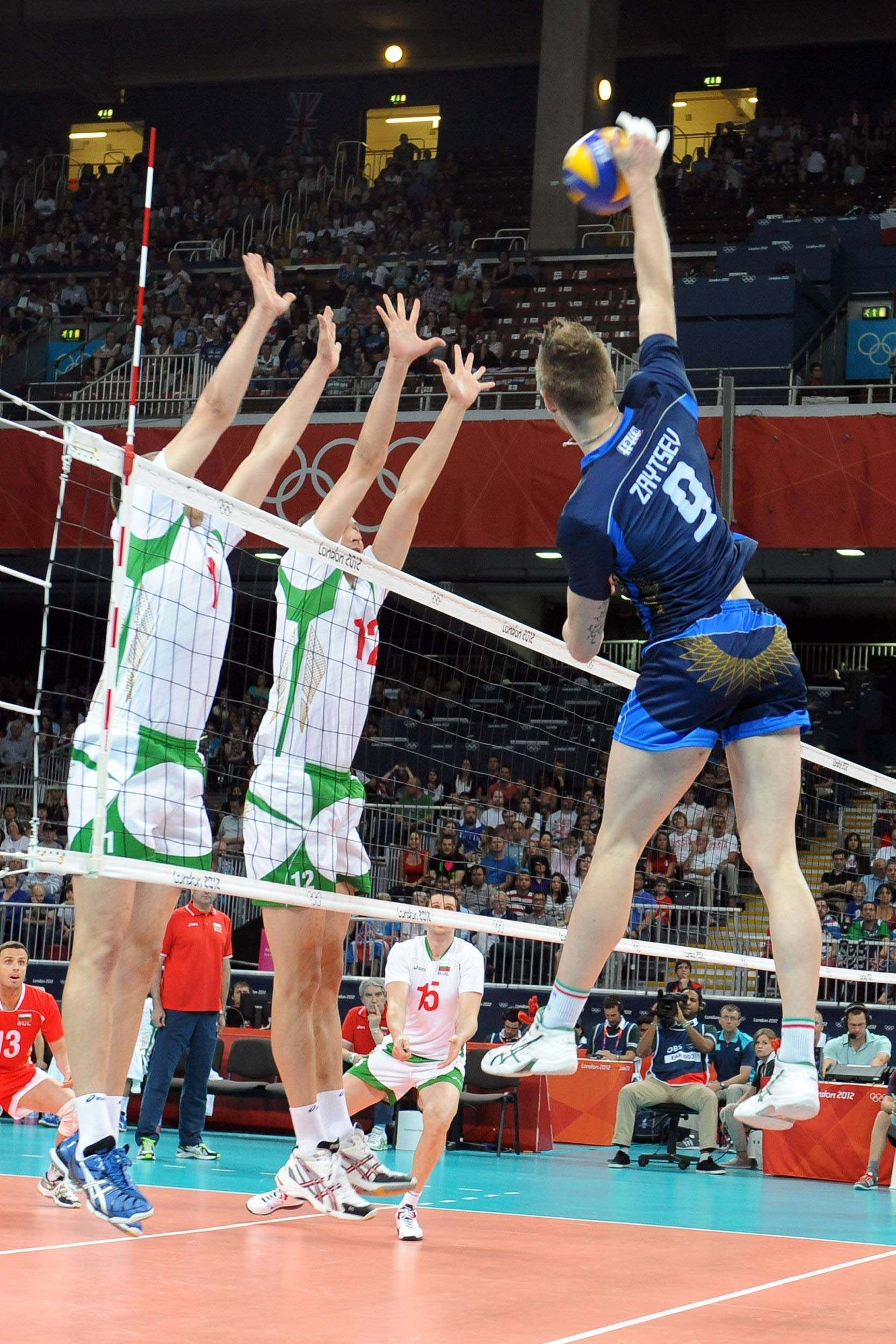 Italy S Ivan Zaytsev Spikes The Ball In The Match Against Bulgaria During The 2012 London Olympics Volleyball Photography Sport Volleyball Volleyball Players