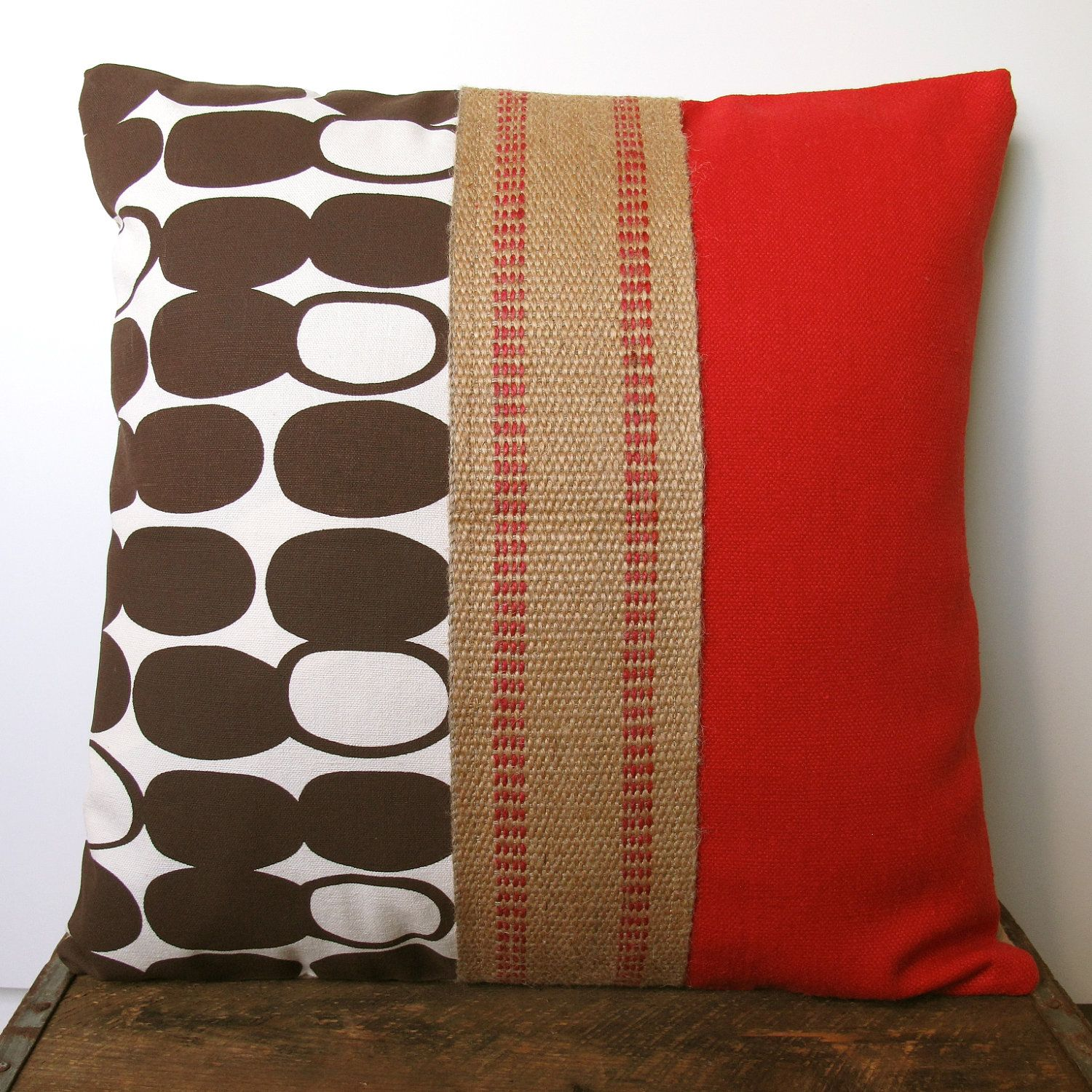 Brown and Red Throw Pillow from Etsy - I could make that.  I have some of that burlap