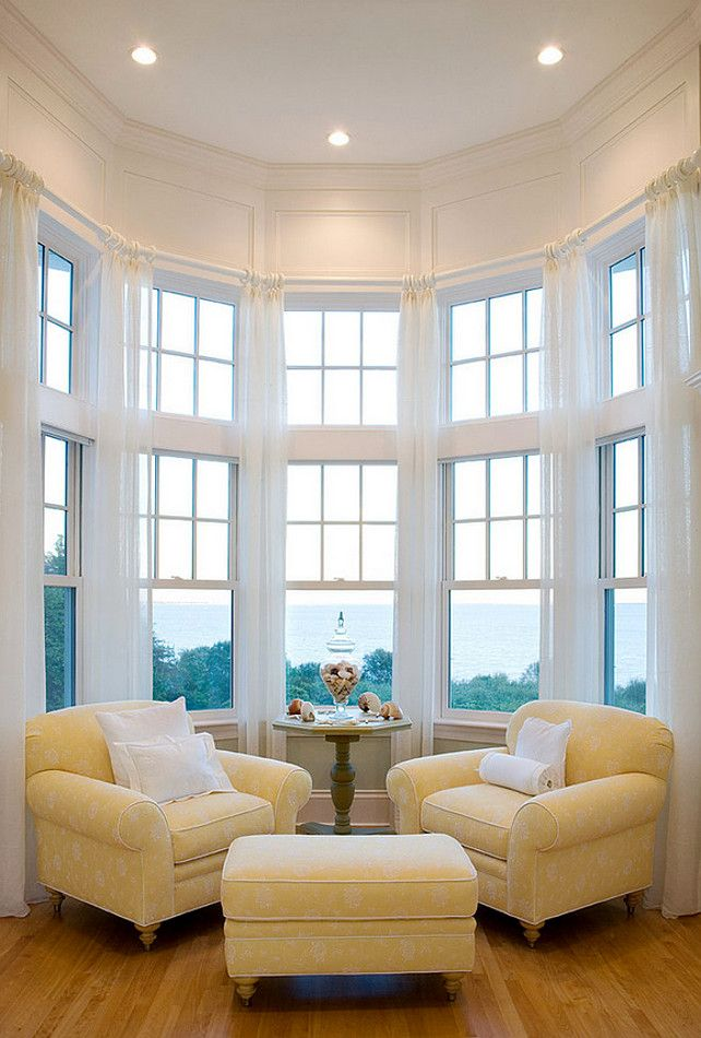 Seating area seating area chairs seating area with ocean - Living room with bay window ...