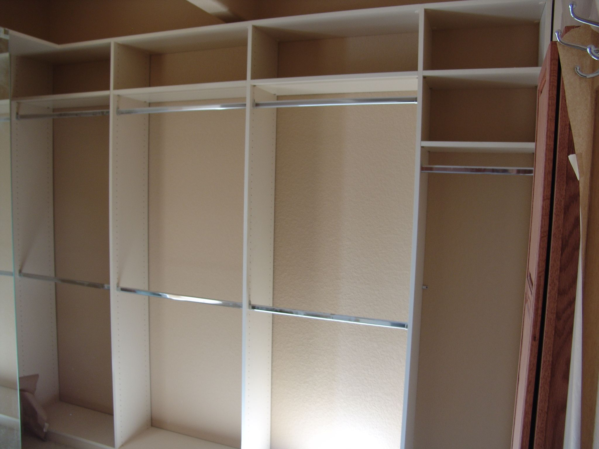 Furniture Pleasing Schemes Of Wardrobe Closet Plans With White Wooden Having Some Metal Clothing Hook Stunning Look Cl