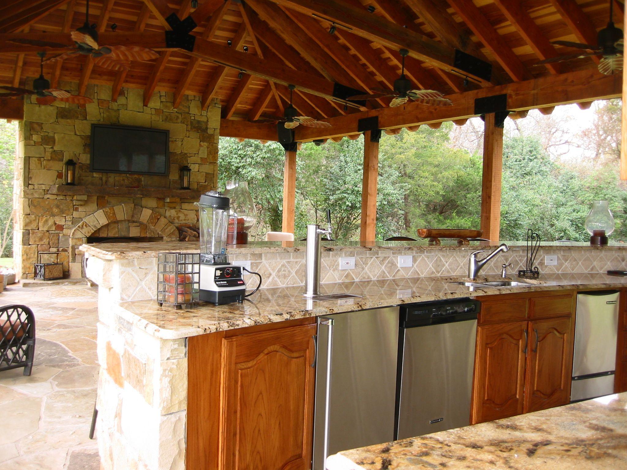 Texas regional design exposed ceiling beams stone facade for Texas outdoor kitchen ideas