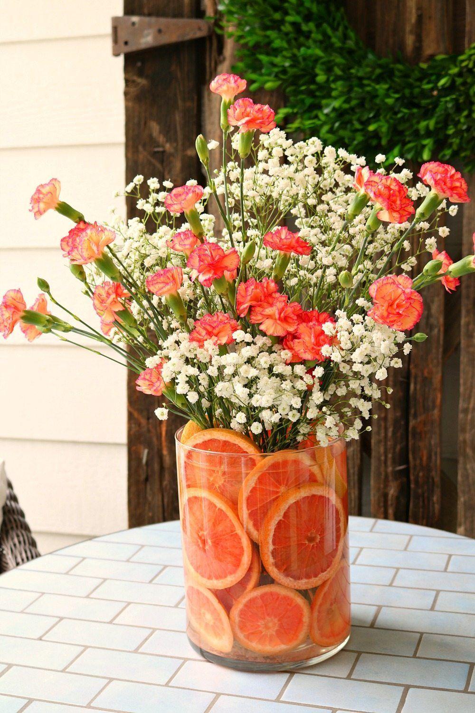 Red Grapefruit And Pink Carnations Make A Sweet Smelling Floral Arrangement Flower Arrangements Diy Spring Flower Arrangements Floral Arrangements Diy