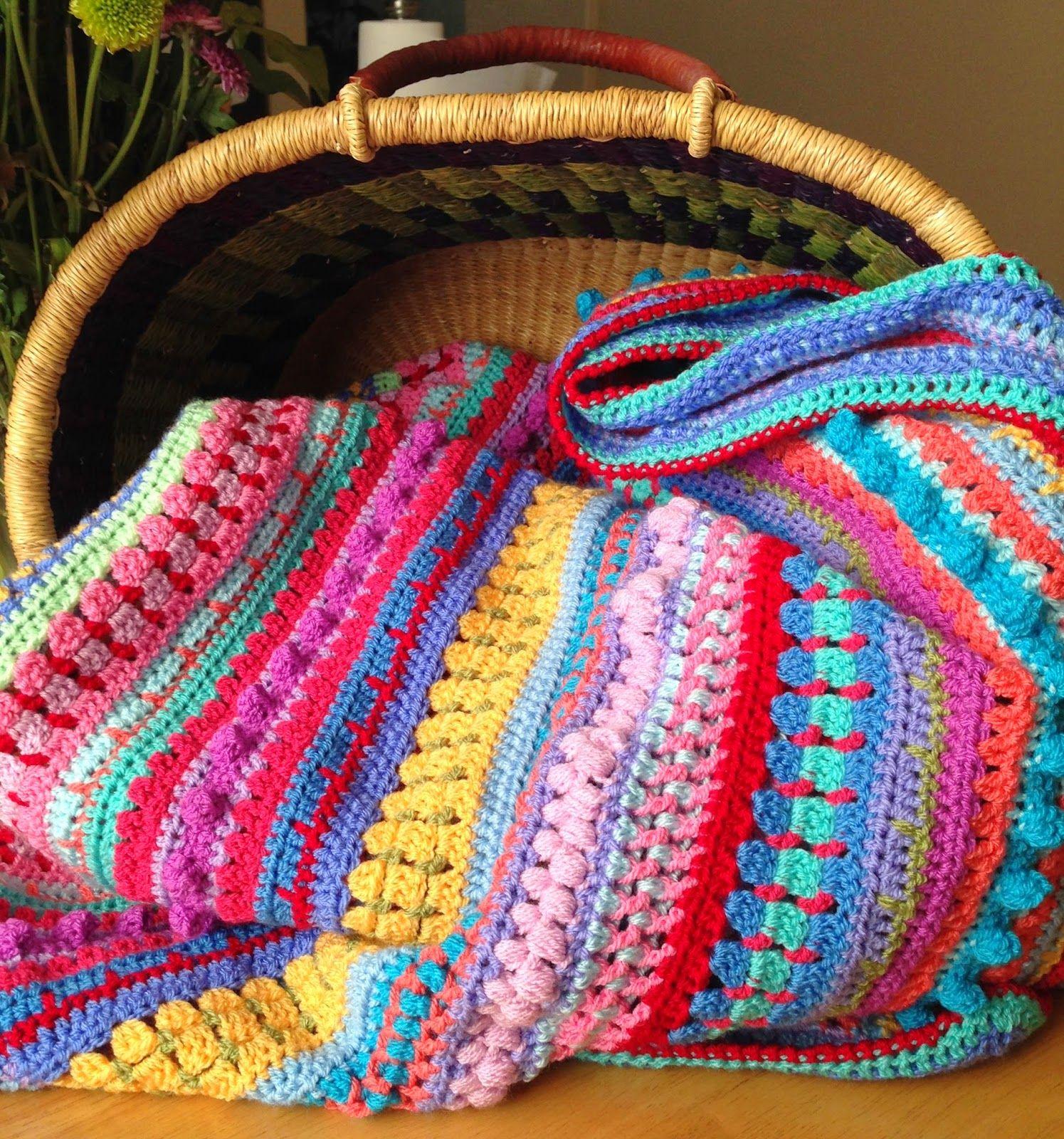 A colorful multi-stitch, multi-stripe blanket. Finished size: 52 1⁄2 ...