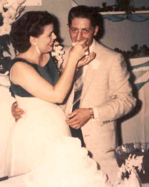 Patsy Cline feeds her newly wed husband (Charlie Dick) a piece of cake.